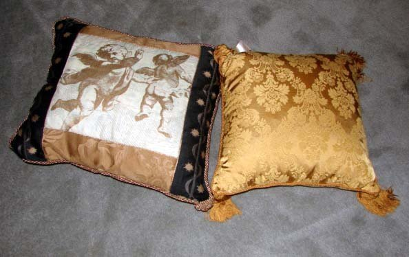 17: Two  Fringed and Tassled Accent Pillows.