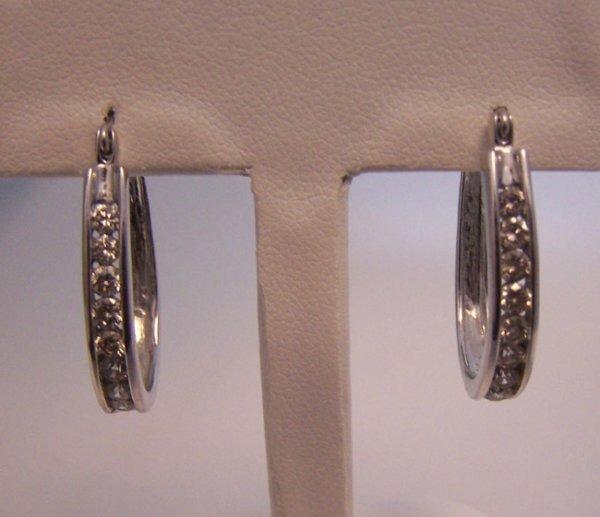 1020: Pair 14k white gold and diamond hoop earrings.
