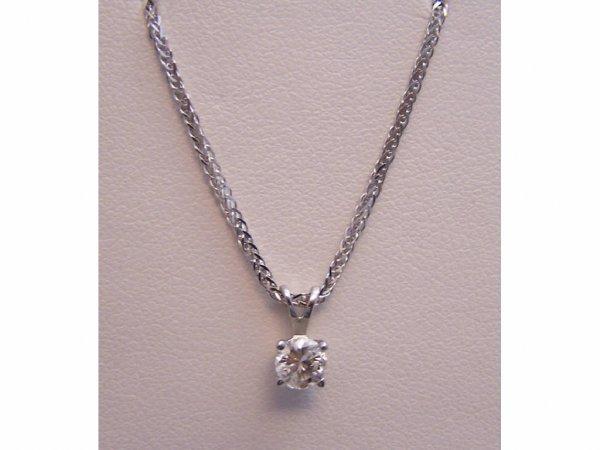 1021: Ladies 14k white gold diamond solitaire/chain.
