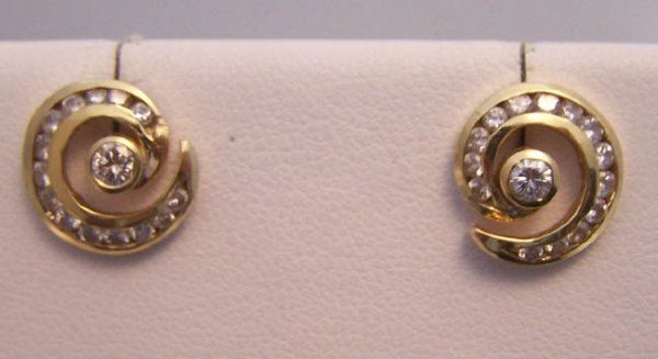 21: Ladies 14K yellow gold and diamond earrings.