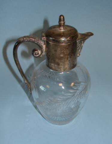 207: Mappin & Webb sterling silver mounted pitcher.