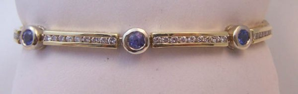 2: Ladies 14K Y/ Gold and Tanzanite Tennis Bracelet.