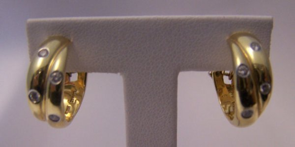 7: Tiffany & Co. 18K Diamond / Gold Earrings.