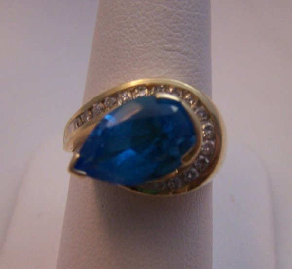 5: 14 Karat yellow gold Blue Topaz and Diamond Ring.