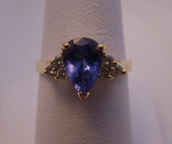 14: 14 K Yellow Gold Tanzanite and Diamond Ring.