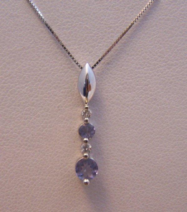 16: Ladies 14K White Gold Tanzanite/Diamond Necklace.