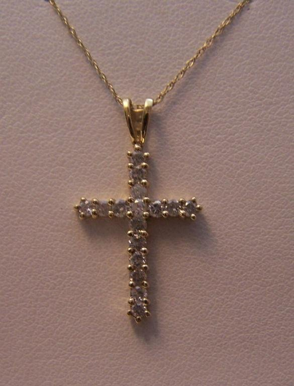 20: Ladies 10K yellow Gold Diamond Cross Necklace.