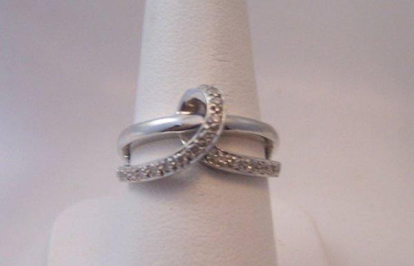 23: 14K White Gold and Diamond Fashion Ring.