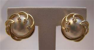 37: 14 K yellow Gold Mabe Pearl and Diamond Earrings
