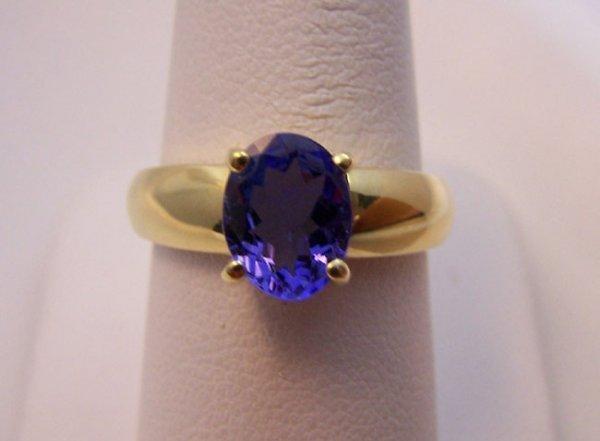 167: 18K Yellow Gold Prong set Tanzanite Ring.