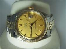 100: S/Steel and 14K Y/ Gold Gents Rolex Oyster Watch.