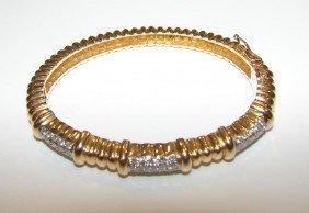 1: 14K yellow gold and diamond hinged bangle bracelet
