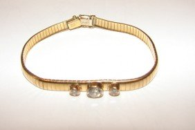 2: 14 K yellow gold and diamond omega bracelet.