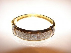 5: 18K y/gold diamond hinged bracelet.