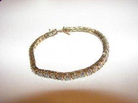6: 14 K y/gold and diamond tennis bracelet.