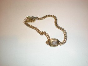 7: 14K yellow gold and diamond curved chain bracelet.