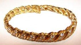 8: 18 K yellow gold diamond tennis bracelet. J. Hess.