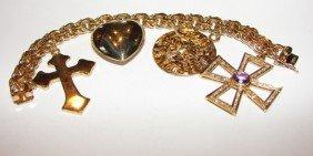 9: 14K Ygold / diamond and amethyst charm bracelet.