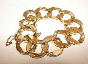 10: 14K yellow gold and diamond curb link bracelet.