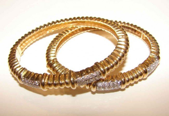 11: Pair  (2) 14K y/ gold and diamond bangle bracelets