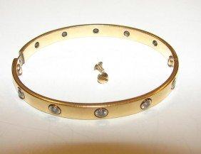 13: 14K y/ gold / bezel set diamond bangle bracelet.