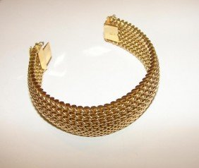 15: 14K yellow gold woven mesh bracelet.