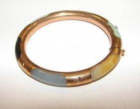 16: 14K yellow gold and jade hinged bangle bracelet.