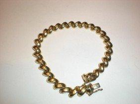 """19: 14K y/gold 7 mm wide """"macaroni"""" link  bracelet."""