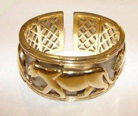 20: 14 K white/yellow gold jaguar relief cuff bracelet
