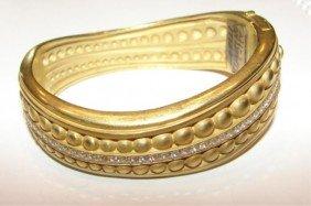 21: 18K yellow gold Keisel Steincord bangle bracelet.