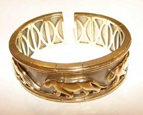 24: 14K yellow/white gold jaguar relief cuff bracelet.