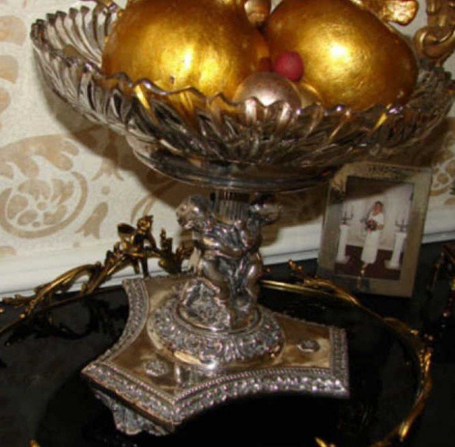 18: Crystal bowl on putti figural silver plated stand.