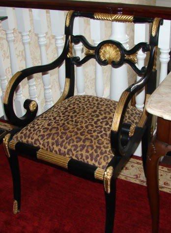24: Pair Regency style ebonized elbow chairs. 20th cen