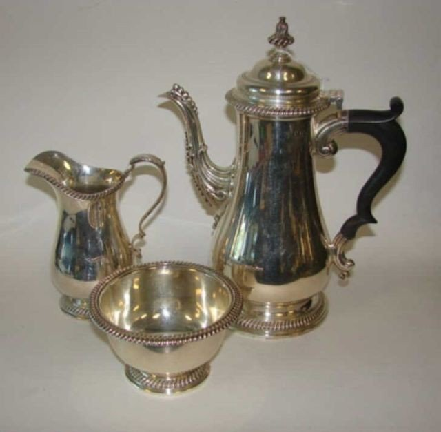 18: English sterling silver coffee service. Dated 1939