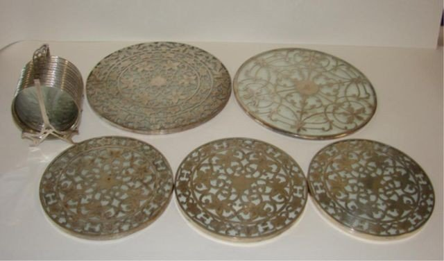 23: Five (5) silver overlay trivets and set coasters.
