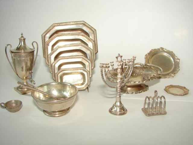 10: Assorted sterling miniature serving articles.
