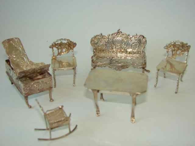 12: Six assorted silver miniature furniture items.