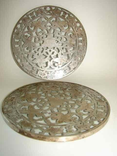 14: Pair of sterling silver overlay trivets.