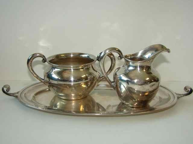 15: Sterling Silver Creamer & sugarbowl on tray.