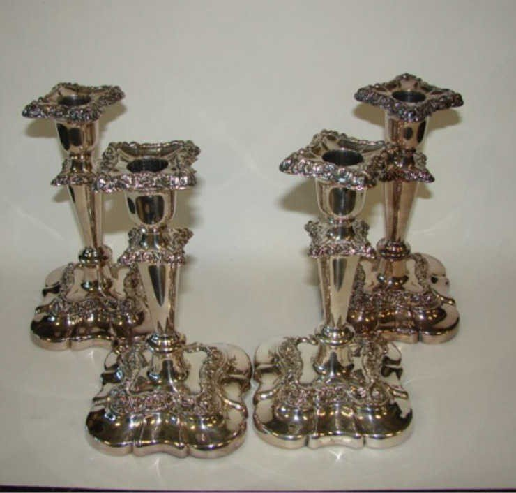 8: Set of four English Sheffield candleholders.