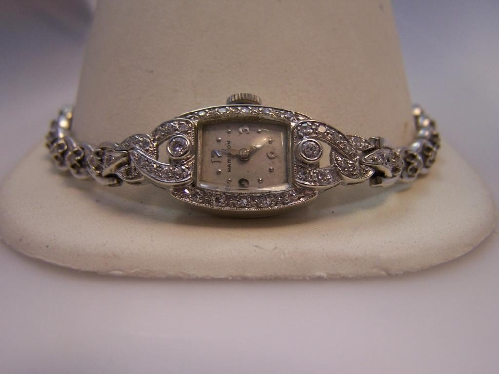 23: 14K White Gold Hamilton Ladies Watch.