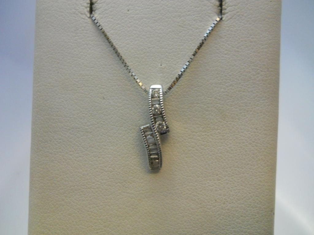 25: 14K White Gold  & Diamond Necklace.