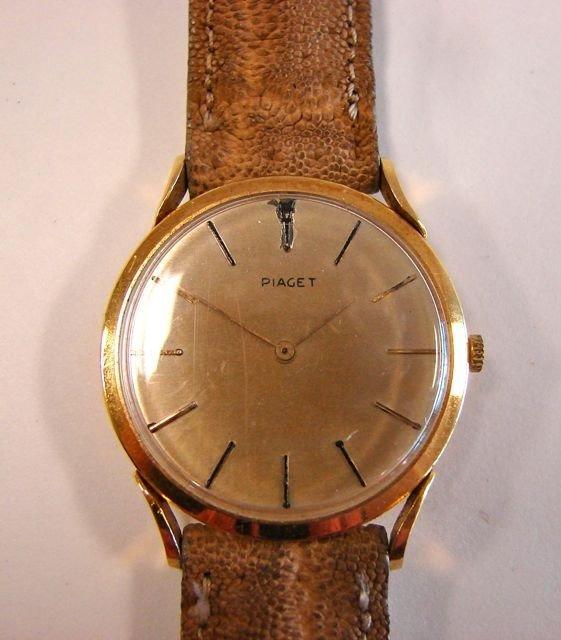 82: Piaget 18K Gold Men's Watch, damaged dial.