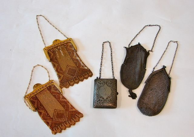 9: German Silver Neccessaire and 4 Mesh Ladies Bags.
