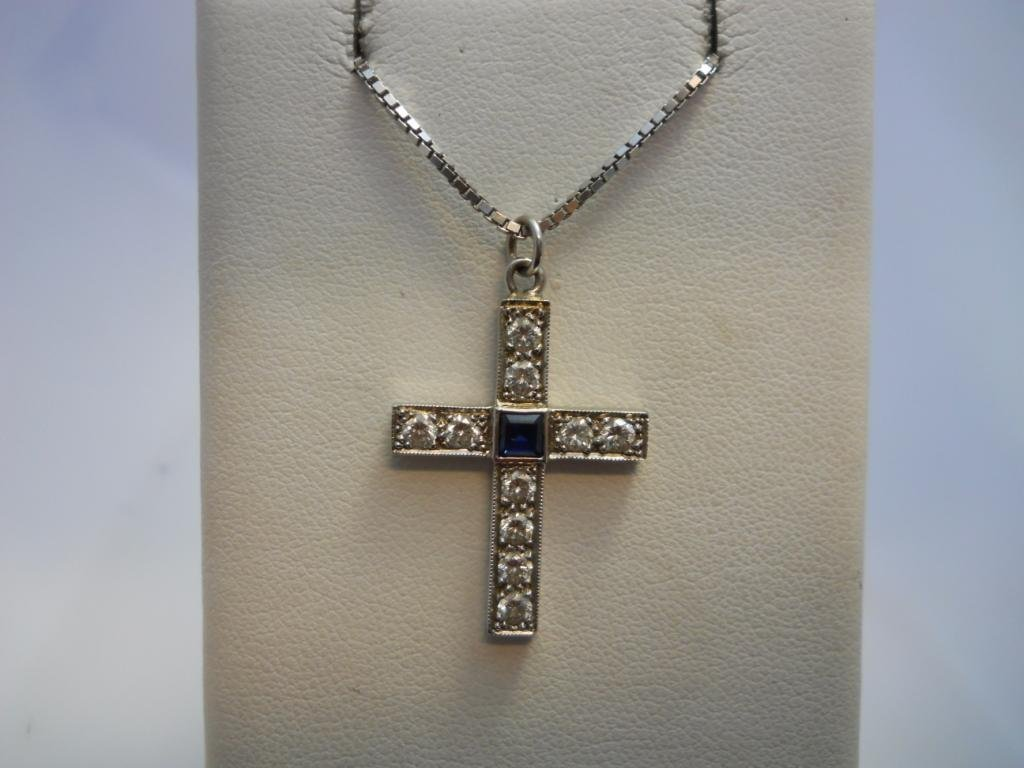11: 14K White Gold Cross Necklace.