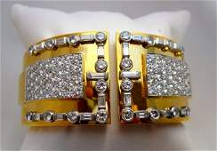 111: Platinum. 18K Gold and Diamond Bangle.
