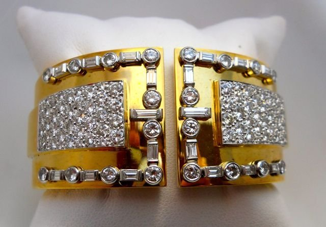 111: Platinum. 18K Gold and Diamond Bangle.