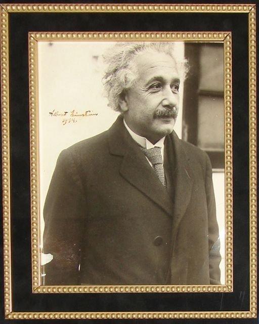 6: Albert Einstein original photo signed, dated. 1934