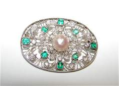 106 Antique Platinum Diamond Emerald Brooch