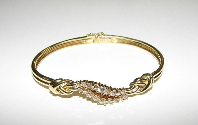 1: Gucci 18K Yellow Gold Diamond Bangle Bracelet.